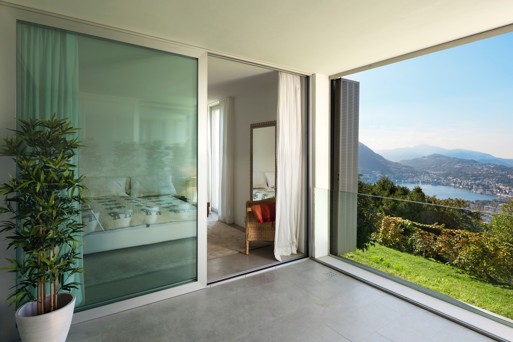Interior of a modern house, balcony overlooking the lake
